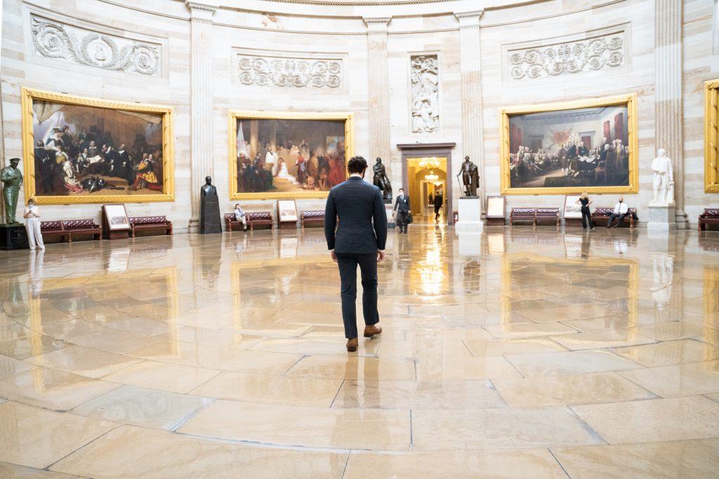 Senator Ossoff from behind walking in the Capitol Rotunda.