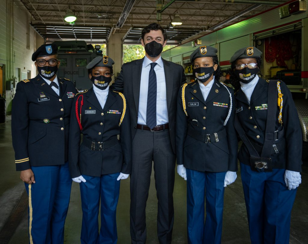 Senator Ossoff, an Army officer, and three Army Junior ROTC members.